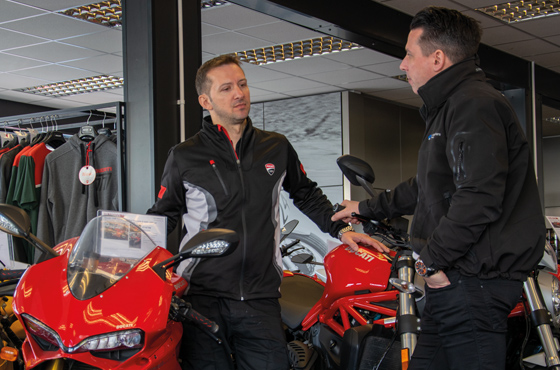 Motorcycle dealer and Motorcycle Account Specialist in discussion